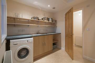The utility-room has lots of storage space, and a cloakroom with WC and wash-basin.