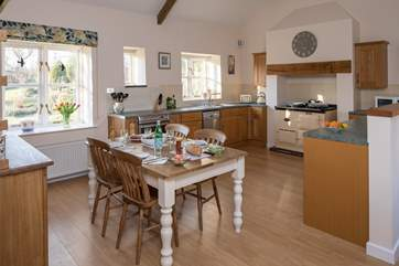 The open plan kitchen/dining-room is very spacious and sociable.