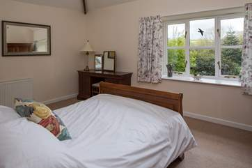 Bedroom 1 has a double bed and en suite bathroom.