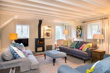 The main sitting-room has a wonderful wood-burner making it the ideal retreat all year round.