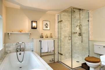 One of 2 bathrooms on the first floor - with a separate bath, shower cubilcle and twin wash-basins.