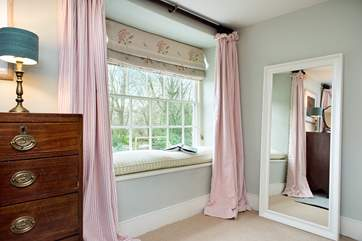 Several of the bedrooms have window seats where you can sit and read a book or simply look out at the beautiful setting.