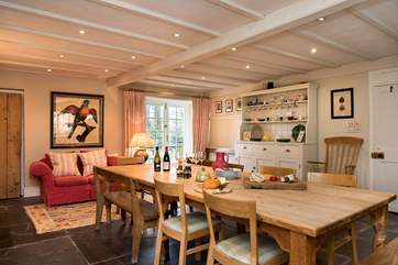Plenty of room for everyone to gather round the kitchen the table. The French windows lead out to the garden.