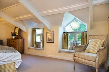 Bedroom 4 is furnished with gorgeous fabrics. Please mind your head on the sloping ceilings.