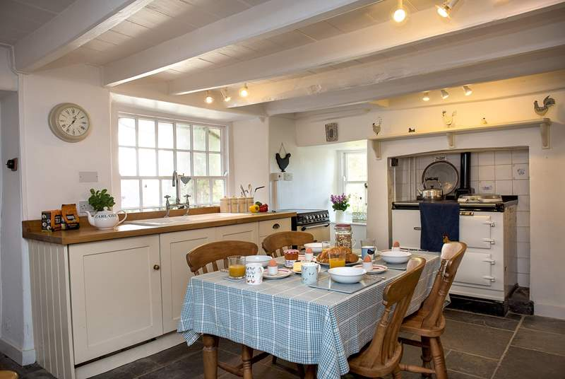 The homely kitchen/breakfast-room sits at the back of the house.