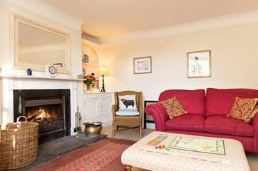 The sitting-room has an open fire, a welcome sight on chillier evenings.