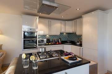 The bespoke kitchen is exceptionally well-equipped to make this lovely property a real home-from-home.