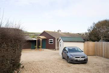 Just steps away from The Stables is the outside utility-room with washing machine and tumble-drier.