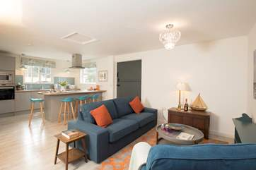 The open space living-room and kitchen area are perfect for entertaining and watching the younger ones play whilst you cook up some lunch.