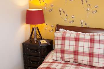 Get an early night with a good book in the inviting master bedroom.