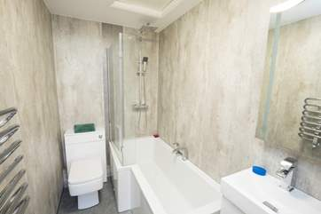 The new modern bathroom to relax in a nice warm bath after your day exporing the Island.