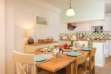 The open plan living-room with kitchen and dining area is a charming space to cook, eat and entertain in.