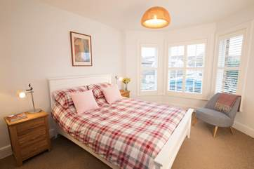 Cosy up in the king-size bed in the master bedroom for a good night's sleep.