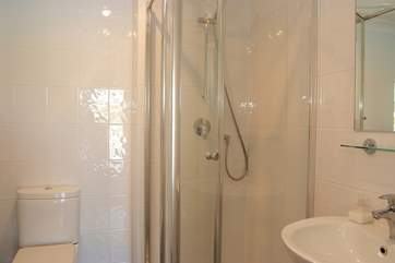 This shower-room is en suite to Bedroom 1.