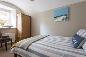 Bedroom 2 has an original vaulted ceiling.