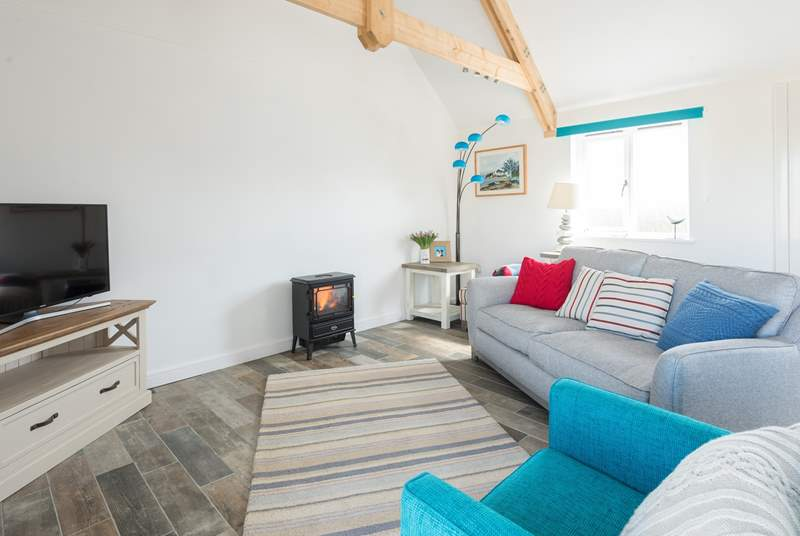 The open plan living space has a warming electric fire.