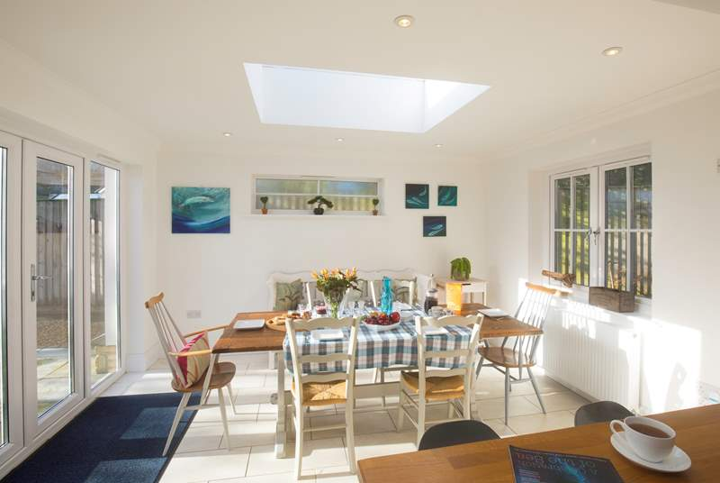 The stunning dining-area has a large table seating eight and patio doors out to the garden to open up on those sunny days.