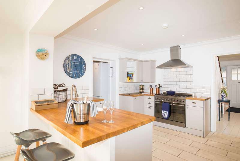 The stunning kitchen/dining-room is a fabulous place for cooking and entertaining whatever the weather is like outside.