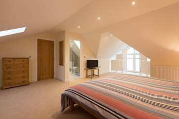The master bedroom is really spacious - take care of the sloping ceiling to the bay leading to the window.