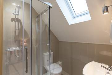 The en suite shower-room is filled with light from the Velux window.