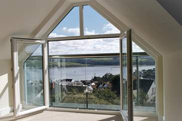 This is the stunning view from the master bedroom - there are bespoke wooden screens that fit the window space.