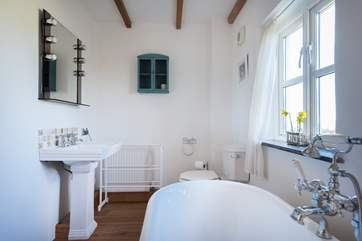 The master ensuite bathroom with roll-top bath.