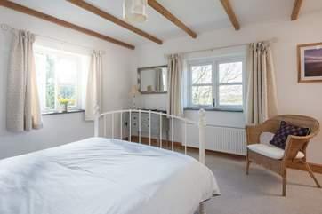 The bedroom has stunning dual-aspect views.