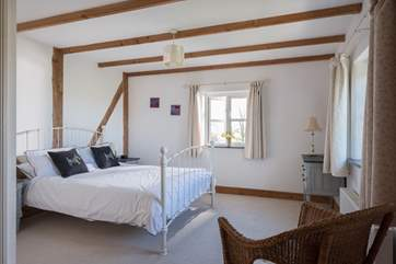 The spacious double bedroom has lovely feautures.
