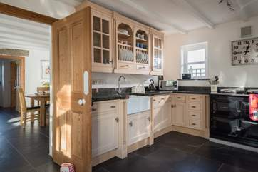 The kitchen is well-equipped and joins the dining-room.