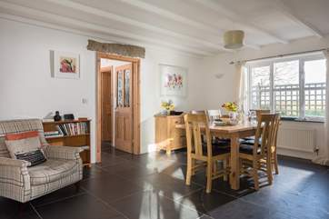 The dining-room with a door that leads to the private garden, shower-room and utility-room.
