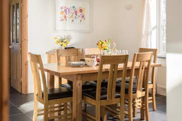 The dining-table for six in a sunny spot.
