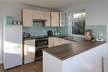 The well-equipped kitchen offers plenty of space to whip up a feast.