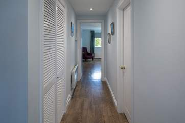 The hallway connects the house wonderfully, this view is leading off down to the master bedroom from the kitchen.