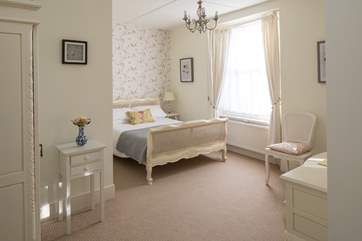 Bedroom 2 is very pretty. With oodles of space and a TV, this is a lovely bedroom to retire to.