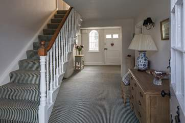 This glorious entrance hall connects the ground floor, with the stairs leading to the grand landing of the first floor.