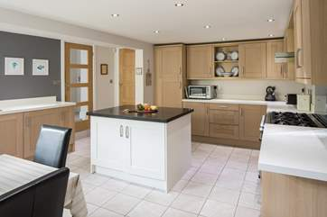The kitchen is a wonderful space to gather for a drink or create a feast fit for a king.