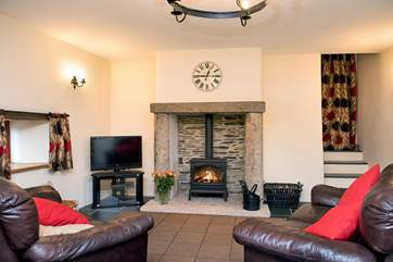 Cosy up in front of the wood-burning stove - a welcome sight on those out-of-season breaks.