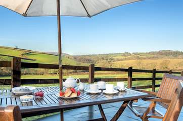 Treat yourself to a cream tea on the terrace - with that view who can blame you!