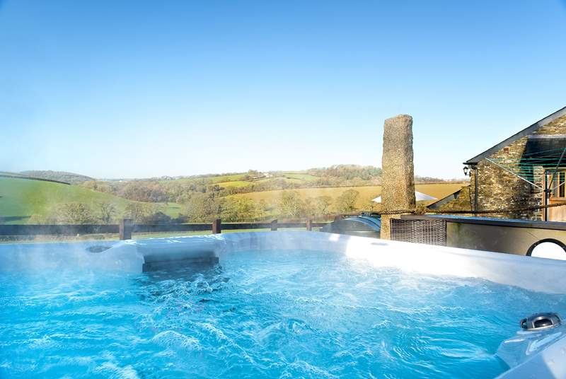 Come to Tregada Barn and relax in the hot tub.