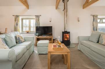 When the weather is not so good sit around the cosy wood-burner and enjoy the glow, however, the under-floor heating will also keep you warm.