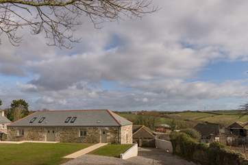 A view of the barns across the farm towards the rolling hills beyond.