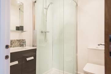 The en suite shower-room has a large corner shower cubicle.