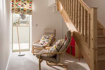 The area at the bottom of the stairs is a quiet space or a play area for the younger ones.