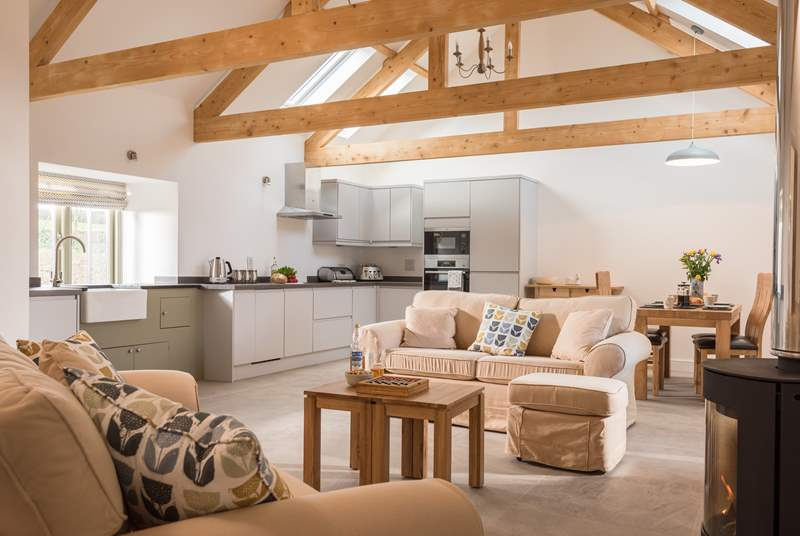 The fabulous open plan living space with exposed beams.