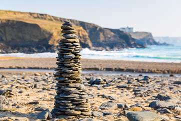 This lovely unspoilt beach, where you can spend time building pebble towers, sand castles or getting wet.