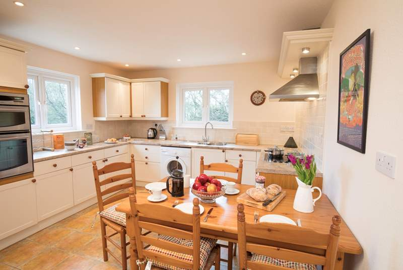 Within the well-equipped kitchen is a lovely place to sit and enjoy holiday meals together.