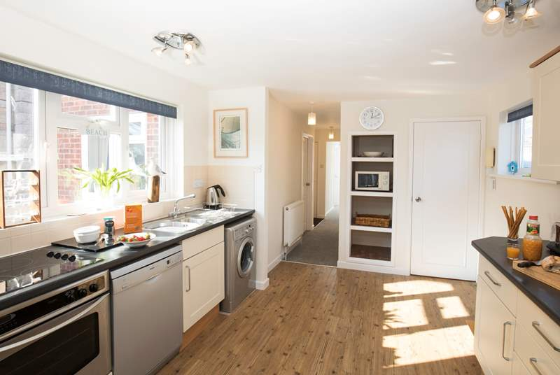 The large kitchen area is fully equipped and has plenty of space for creative cooking.