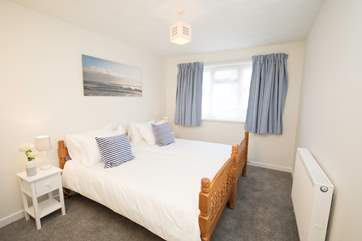 The apartment has three lovely bedrooms, including this delightful twin bedroom.