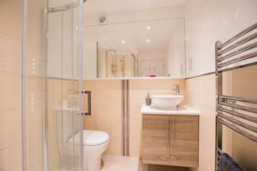 The modern en suite off the master bedroom for a peaceful morning shower.