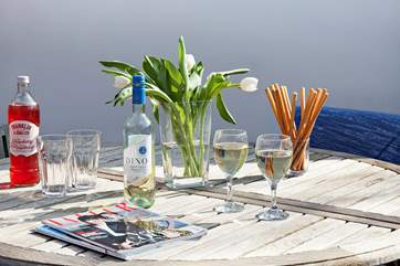 Enjoy a chilled drink in the sun with a light snack and a read of a magazine or favourite book